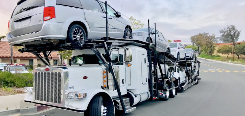 car-carrier-auto-transport-truck-filled-with-cars-ready-for-a-cross-country-road-trip-delivery_t20_4bdxe8